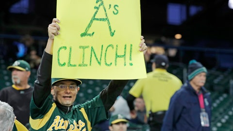 "<p>               A fan holds a sign that reads ""A's Clinch!"" before a baseball game between the Seattle Mariners and the Oakland Athletics, Friday, Sept. 27, 2019, in Seattle. The Athletics clinched a wild-card berth in the American League before the first pitch of their game when the Cleveland Indians lost to the Washington Nationals. (AP Photo/Ted S. Warren)             </p>"
