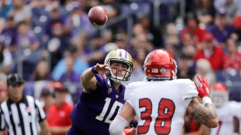 <p>               Washington quarterback Jacob Eason (10) throws a touchdown pass as Eastern Washington's Joe Lang defends in the first half of an NCAA college football game Saturday, Aug. 31, 2019, in Seattle. (AP Photo/Elaine Thompson)             </p>