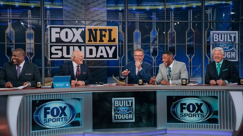 """<p>               In this 2018 photo provided by Fox Sports, Curt Menefee, Terry Bradshaw, Howie Long, Michael Strahan and Jimmy Johnson, from left, get ready for the """"Fox NFL Sunday"""" pregame show during the 2018 season at the Fox Sports studio in Los Angeles. The show, which started in 1994, was inducted into the NAB Broadcasting Hall of Fame earlier this year. (Fox Sports via AP)             </p>"""