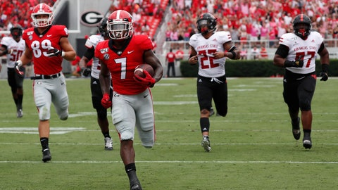 <p>               Georgia running back D'Andre Swift (7) is chased by the Arkansas State defense as he scores a touchdown in the first half of an NCAA college football game Saturday, Sept. 14, 2019, in Athens, Ga. (AP Photo/John Bazemore)             </p>