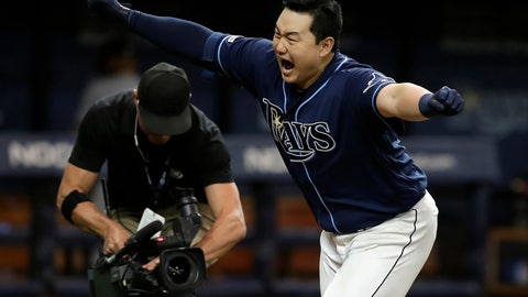 <p>               Tampa Bay Rays' Ji-Man Choi celebrates after his walkoff home run against New York Yankees relief pitcher Cory Gearrin during the 12th inning of a baseball game Tuesday, Sept. 24, 2019, in St. Petersburg, Fla. (AP Photo/Chris O'Meara)             </p>