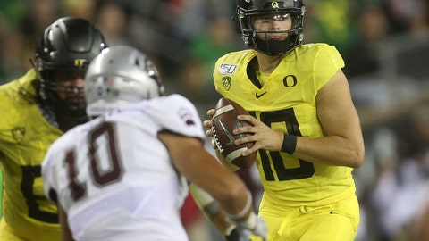 <p>               Oregon's Justin Herbert, right, looks down field against Montana during the third quarter of an NCAA college football game Saturday, Sept. 14, 2019, in Eugene, Ore. (AP Photo/Chris Pietsch)             </p>