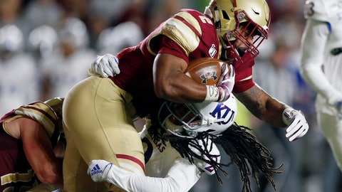 <p>               Kansas cornerback Corione Harris, bottom, tackles Boston College running back AJ Dillon during the first half of an NCAA college football game in Boston, Friday, Sept. 13, 2019. (AP Photo/Michael Dwyer)             </p>