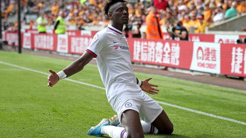 <p>               Chelsea's Tammy Abraham celebrates scoring his side's fourth goal of the game and his hat-trick during their English Premier League soccer match against Wolverhampton Wanderers at Molineux, Wolverhampton, England, Saturday, Sept. 14, 2019. (Nick Potts/PA via AP)             </p>