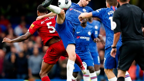 <p>               Chelsea's Jorginho goes for the ball during the British Premier League soccer match between Chelsea and Liverpool, at the Stamford Bridge Stadium, London, Sunday, Sept. 22, 2019. (AP Photo/Frank Augstein)             </p>