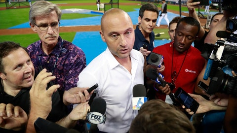 <p>               FILE - In this June 10, 2019, file photo, Miami Marlins CEO Derek Jeter, center, talks with members of the media before the start of a baseball game between the Marlins and the St. Louis Cardinals, in Miami. Derek Jeter watched the first pitch on opening day from the owner's box next to the dugout, but within a few innings retreated to a more secluded location and rarely returned to his field-level seat during the season. Alas, from whatever vantage point, Jeter's team looked bad. (AP Photo/Wilfredo Lee, File)             </p>