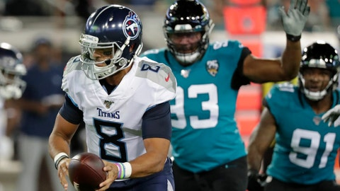 <p>               Tennessee Titans quarterback Marcus Mariota (8) looks to hand off the ball as he is pressured by Jacksonville Jaguars defensive end Calais Campbell, right, during the first half of an NFL football game, Thursday, Sept. 19, 2019, in Jacksonville, Fla. (AP Photo/John Raoux)             </p>