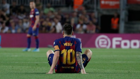 <p>               Barcelona's Lionel Messi sits on the ground after getting hurt during the Spanish La Liga soccer match between FC Barcelona and Villarreal CF at the Camp Nou stadium in Barcelona, Spain, Tuesday, Sep. 24, 2019. (AP Photo/Joan Monfort)             </p>