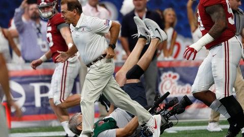 <p>               A cameraman falls as Alabama head coach Nick Saban leads his team onto the field to warm before an NCAA college football game against Duke Saturday, Aug. 31, 2019, in Atlanta. (AP Photo/John Bazemore)             </p>