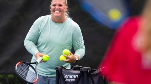 <p>               DELETES REFERENCE TO OUDIN BEATING THREE OTHER SEEDED PLAYERS ALONG THE WAY - Retired tennis player Melanie Oudin coaches young players at Windward Lake Club, Monday, Aug. 26, 2019, in Alpharetta, Ga.  In 2009, Oudin pulled off four upsets at the U.S. Open, including against Maria Sharapova, to become the youngest quarterfinalist at Flushing Meadows since Serena Williams in 1999.  (AP Photo/John Amis)             </p>