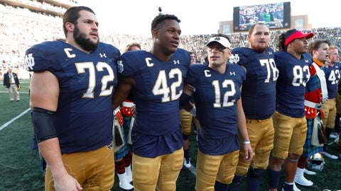 <p>               Notre Dame's Robert Hainsey (72), Julian Okwara (42), Ian Book (12) and Tommy Kraemer (78) sing after beating New Mexico 66-14 after an NCAA college football game in South Bend, Ind., Saturday, Sept. 14, 2019. (AP Photo/Paul Sancya)             </p>