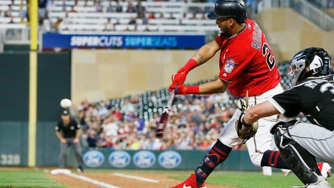 <p>               Minnesota Twins' Eddie Rosario hits an RBI double off Chicago White Sox pitcher Ross Detwiler in the third inning of a baseball game Tuesday, Sept. 17, 2019, in Minneapolis. (AP Photo/Jim Mone)             </p>
