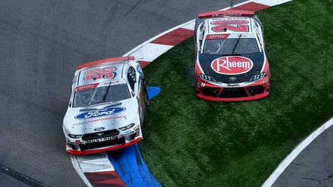 <p>               Chase Briscoe, (98) and Christopher Bell, (20) run off the course in Turn 17, resulting in a penalty for Bell, during a NASCAR Xfinity Series auto race at Charlotte Motor Speedway, Saturday, Sept. 28, 2019, in Concord, N.C. (AP Photo/Mike McCarn)             </p>