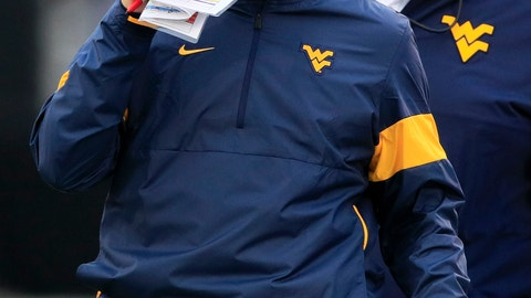 <p>               West Virginia head coach Neal Brown covers his mouth while talking on his headset during the second half of an NCAA college football game against Kansas in Lawrence, Kan., Saturday, Sept. 21, 2019. West Virginia defeated Kansas 29-24. (AP Photo/Orlin Wagner)             </p>