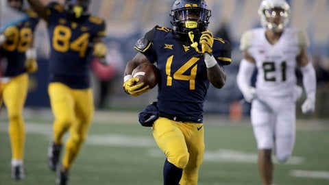 <p>               FILE - In this Oct. 25, 2018, file photo, West Virginia running back Tevin Bush (14) runs for a touchdown during the first half of an NCAA college football game against Baylor, in Morgantown, W.Va. Bush set career highs of four catches for 74 yards in a 20-13 win over James Madison and will be looking for more when the Mountaineers travel to face Missouri on Saturday. (AP Photo/Raymond Thompson, File)             </p>