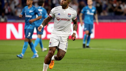 <p>               Lyon's Memphis Depay celebrates after scoring his side's opening goal from a penalty shot during the group G Champions League soccer match between Lyon and Zenit St Petersburg at the Lyon Olympic Stadium in Lyon, France, Tuesday, Sept. 17, 2019. (AP Photo/Laurent Cipriani)             </p>