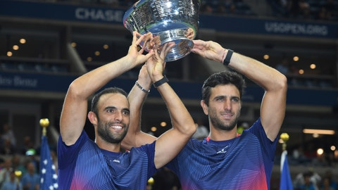 <p>               Juan Sebastian Cabal, left, and Robert Farah, both of Colombia, hold up the championship trophy after defeating Marcel Granollers, of Spain, and Horacio Zeballos during the men's doubles final of the U.S. Open tennis championships Friday, Sept. 6, 2019, in New York. (AP Photo/Sarah Stier)             </p>