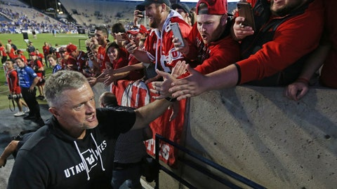 <p>               Utah head coach Kyle Whittingham greets fans after defeating BYU at an NCAA college football game, Thursday, Aug. 29, 2019, in Provo, Utah. Utah defeated BYU 30-12. (AP Photo/George Frey)             </p>