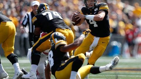 <p>               Iowa quarterback Nate Stanley runs the ball against Rutgers during the second half of an NCAA college football game, Saturday, Sept. 7, 2019, in Iowa City. Iowa won 30-0. (AP Photo/Matthew Putney)             </p>