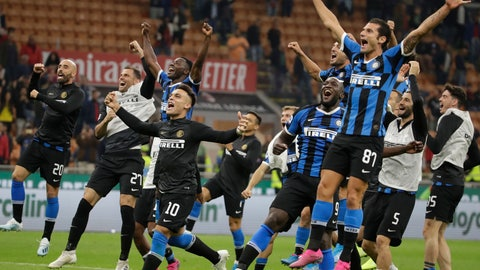 <p>               Inter Milan's players celebrate at the end of a Serie A soccer match between AC Milan and Inter Milan, at the San Siro stadium in Milan, Italy, Saturday, Sept.21, 2019. (AP Photo/Luca Bruno)             </p>
