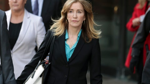 """<p>               FILE - This April 3, 2019 file photo shows actress Felicity Huffman departing federal court in Boston after facing charges in a nationwide college admissions bribery scandal. Federal prosecutors are asking a judge to sentence """"Desperate Housewives"""" star Felicity Huffman to a month in jail for her role in the sweeping college admissions bribery scandal. (AP Photos/Charles Krupa, File)             </p>"""