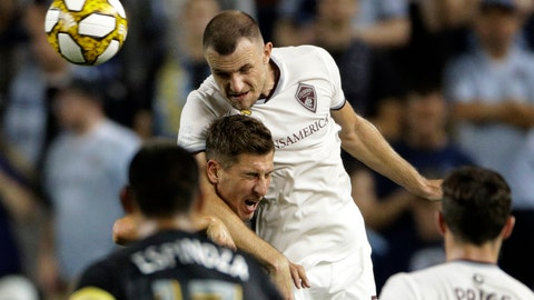 <p>               Colorado Rapids defender Tommy Smith, left, and Sporting Kansas City forward Krisztian Nemeth battle for the ball during the first half of an MLS soccer match, Saturday, Sept. 21, 2019, in Kansas City, Kan. (AP Photo/Charlie Riedel)             </p>