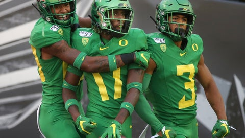 <p>               Oregon's Bryan Addison, left, Daewood Davis and Johnny Johnson III celebrate a fourth-quarter interception that Davis ran back for a touchdown against Nevada in an NCAA college football game Saturday, Sept. 7, 2019, in Eugene, Ore. (AP Photo/Chris Pietsch)             </p>