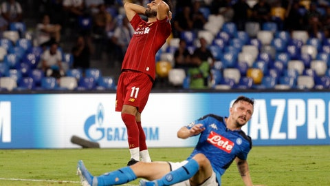 <p>               Liverpool's Mohamed Salah reacts during the Champions League Group E soccer match between Napoli and Liverpool, at the San Paolo stadium in Naples, Italy, Tuesday, Sept. 17, 2019. (AP Photo/Gregorio Borgia)             </p>