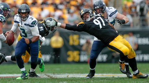 <p>               Seattle Seahawks quarterback Russell Wilson (3) scrambles away from Pittsburgh Steelers defensive end Cameron Heyward (97) on his way to a first down in the second half of an NFL football game, Sunday, Sept. 15, 2019, in Pittsburgh. (AP Photo/Don Wright)             </p>