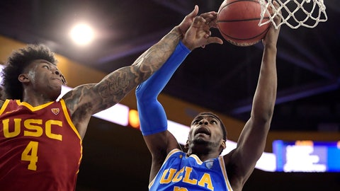 <p>               FILE - In this Feb. 28, 2019, file photo, UCLA forward Cody Riley, right, grabs a rebound away from Southern California guard Kevin Porter Jr. during the first half of an NCAA college basketball game in Los Angeles. The NCAA's Board of Governors is urging Gov. Gavin Newsom not to sign a California bill that would allow college athletes to receive money for their names, likenesses or images. In a six-paragraph letter to Newsom, the board said the bill would give California schools an unfair recruiting advantage. As a result, the letter says, the NCAA would declare those schools ineligible for its events. (AP Photo/Mark J. Terrill, File)             </p>