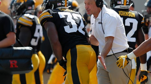 <p>               Iowa head coach Kirk Ferentz, right, talks with Iowa linebacker Djimon Colbert, left, after a play during the second half of an NCAA college football game against Rutgers, Saturday, Sept. 7, 2019, in Iowa City. Iowa won 30-0. (AP Photo/Matthew Putney)             </p>