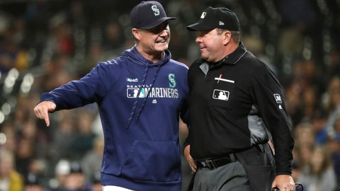 <p>               Seattle Mariners manager Scott Servais, left, argues with home plate umpire Sam Holbrook after Servais was ejected from the baseball game against the Houston Astros during the seventh inning Wednesday, Sept. 25, 2019, in Seattle. (AP Photo/Elaine Thompson)             </p>