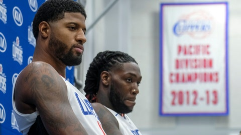 <p>               Los Angeles Clippers forwards Paul George, left, and Montrezl Harrell attend the NBA basketball team's media day in Los Angeles, Sunday, Sept. 29, 2019. (AP Photo/Ringo H.W. Chiu)             </p>
