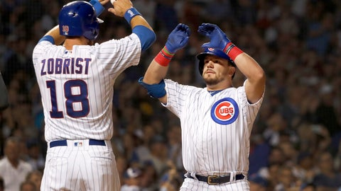 <p>               Chicago Cubs' Kyle Schwarber, right, celebrates his three-run home run off Cincinnati Reds starting pitcher Kevin Gausman with Ben Zobrist during the first inning of a baseball game Monday, Sept. 16, 2019, in Chicago. Kris Bryant also scored the play. (AP Photo/Charles Rex Arbogast)             </p>