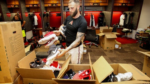 <p>               Arizona Diamondbacks' Christian Walker places shoes in boxes while cleaning out his locker after their 1-0 win over the San Diego Padres Sunday, Sept. 29, 2019, in Phoenix. The Arizona Diamondbacks finished the season with 85 wins and 77 loses. (AP Photo/Darryl Webb)             </p>