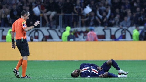 <p>               Referee Ruddy Buquet, left, looks at PSG's Neymar who lies injured on the pitch during the French League 1 soccer match between Lyon and Paris SG, at the Stade de Lyon in Decines, outside Lyon, France, Sunday, Sept. 22, 2019. (AP Photo/Laurent Cipriani)             </p>