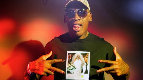"""<p>               In this Monday, Sept. 9, 2019, photo, former NBA star Dennis Rodman poses wearing a T-shirt depicting himself in a wedding dress at a 1996 book promo event, in Los Angeles. After a career of spectacular highs and very public lows, Dennis Rodman keeps finding new ways to surprise. The former NBA star, featured in a new ESPN documentary, weighs in on his personal brand, bisexual athletes, North Korea and Trump. Rodman's spectacular personal highs and very public lows are the subject of the new ESPN """"30 For 30"""" documentary """"Dennis Rodman: For Better or Worse.""""  (AP Photo/Damian Dovarganes)             </p>"""