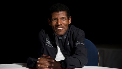 <p>               FILE - In this Wednesday, April 9, 2014 file photo, former marathon world record holder Ethiopia's Haile Gebrselassie, poses for photographers at a hotel in London. Gebrselassie says it was wrong to hold the track and field world championships in Qatar and marathon runners could have died from the heat. The women's marathon Friday, Sept. 27, 2019 started at midnight to dodge the worst of the heat in Qatar but was still held in humidity that made it feel like 105 degrees (40 Celsius). Twenty-eight of the 68 women dropped out and one was briefly hospitalized. (AP Photo/Matt Dunham, File)             </p>