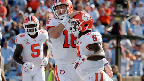 <p>               Clemson's Travis Etienne (9) celebrates his touchdown with Trevor Lawrence (16) and Tee Higgins (5) during the second quarter of an NCAA college football game against North Carolina in Chapel Hill, N.C., Saturday, Sept. 28, 2019. (AP Photo/Chris Seward)             </p>
