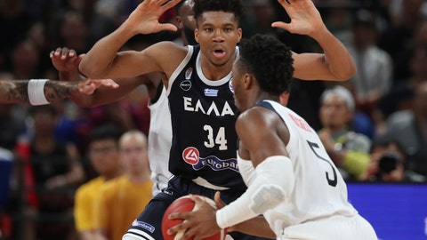 <p>               Greece's Giannis Antetokounmpo tries to block United States' Donovan Mitchell during phase two of the FIBA Basketball World Cup at the Shenzhen Bay Sports Center in Shenzhen in southern China's Guangdong province on Saturday, Sept. 7, 2019. United States beat Greece 69-53. (AP Photo/Ng Han Guan)             </p>