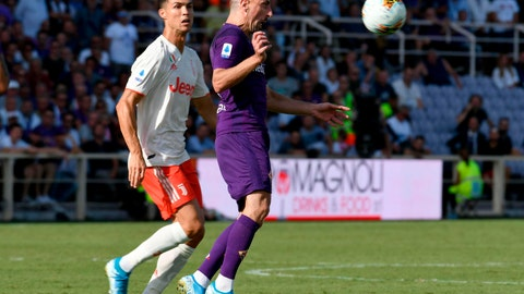 <p>               Fiorentina's Franck Ribery, right, and Juventus' Cristiano Ronaldo go for the ball during the Serie A soccer match between Fiorentina and Juventus, at the Artemio Franchi stadium in Florence, Italy, Saturday, Sept. 14, 2019. (Claudio Giovannini/ANSA via AP)             </p>