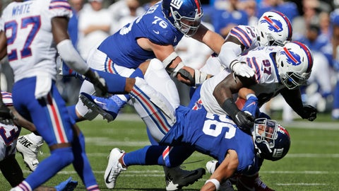 <p>               Buffalo Bills defense tackles New York Giants' Saquon Barkley, bottom, during the second half of an NFL football game, Sunday, Sept. 15, 2019, in East Rutherford, N.J. (AP Photo/Adam Hunger)             </p>