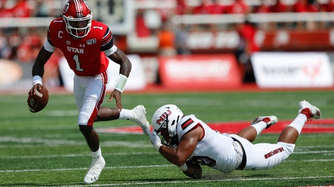 <p>               Utah quarterback Tyler Huntley (1) breaks from a Northern Illinois tackler in the first half of an NCAA college football game Saturday, Sept. 9, 2019, Salt Lake City. (AP Photo/Rick Bowmer)             </p>