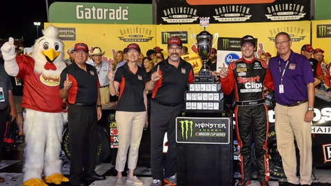 <p>               Erik Jones poses for a photo with his trophy after winning a NASCAR Cup Series auto race on Sunday, Sept. 1, 2019, at Darlington Raceway in Darlington, S.C. Jones held off Joe Gibbs Racing teammate Kyle Busch to win the rain-delayed Southern 500 that ended early Monday morning. (AP Photo/Richard Shiro)             </p>