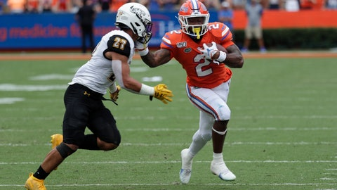 <p>               Florida running back Lamical Perine, right, tries to avoid Towson safety S.J. Brown II (27) during the first half of an NCAA college football game, Saturday, Sept. 28, 2019, in Gainesville, Fla. (AP Photo/John Raoux)             </p>