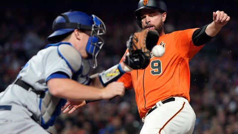 <p>               San Francisco Giants' Brandon Belt (9) beats the tag by Los Angeles Dodgers catcher Will Smith, left, on a sacrifice fly by Kevin Pillar during the third inning of a baseball game Friday, Sept. 27, 2019, in San Francisco. (AP Photo/Tony Avelar)             </p>