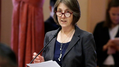 <p>               FILE - In this May 30, 2018, file photo, state Sen. Nancy Skinner, D-Berkeley, speaks on the floor of the Senate in Sacramento, Calif. The state Assembly approved Skinner's bill to let college athletes hire agents and be paid for the use of their name, images or likeness. And it would stop the universities and the NCAA from banning athletes that took the money. The bill now goes to the Senate for a final vote. (AP Photo/Rich Pedroncelli, File)             </p>