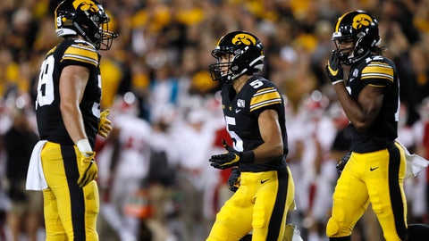 <p>               Iowa wide receiver Oliver Martin, center, celebrates with teammates Nate Wieting, left, and Brandon Smith, right, after catching a touchdown pass during the second half of an NCAA college football game against Miami of Ohio, Saturday, Aug. 31, 2019, in Iowa City, Iowa. Iowa won 38-14. (AP Photo/Charlie Neibergall)             </p>
