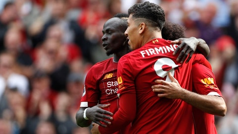<p>               Liverpool's Sadio Mane, left, celebrates with Liverpool's Roberto Firmino, center, and Liverpool's Mohamed Salah, right, after scoring his sides second goal during the English Premier League soccer match between Liverpool and Newcastle at Anfield stadium in Liverpool, England, Saturday, Sept. 14, 2019. (AP Photo/Rui Vieira)             </p>
