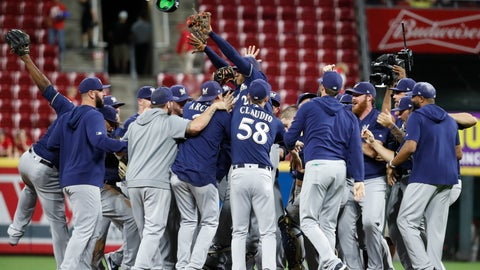 <p>               The Milwaukee Brewers celebrate a 9-2 win over the Cincinnati Reds in a baseball game Wednesday, Sept. 25, 2019, in Cincinnati. (AP Photo/John Minchillo)             </p>